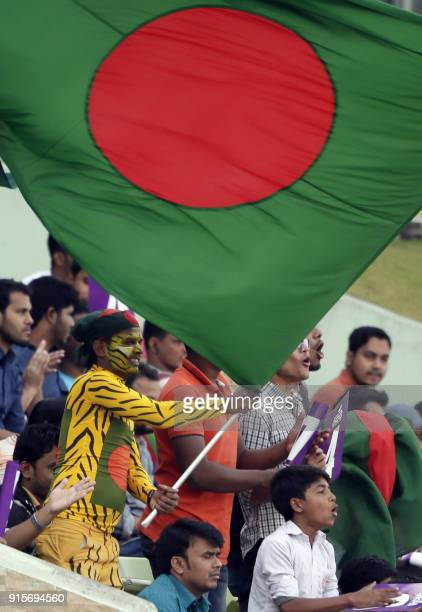 A Bangladeshi cricket fan weaves the national flag during the first day of the second cricket Test between Bangladesh and Sri Lanka at the...