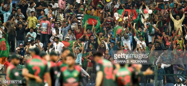 Bangladeshi cricket fans cheer during the one day international Asia Cup cricket match between Bangladesh and Pakistan at the Sheikh Zayed Stadium in...