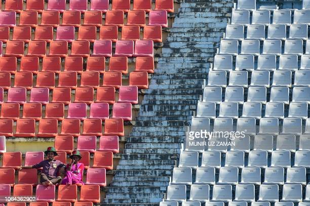 TOPSHOT Bangladeshi cricket fans enjoy the second day of the first Test cricket match between Bangladesh and West Indies at the Zahur Ahmed Chowdhury...
