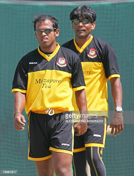Bangladeshi cricket spin bowlers Rajin Saleh and Mohammad Rafique attend a team training session in Couva, in central Trinidad and Tobago, 13 March...