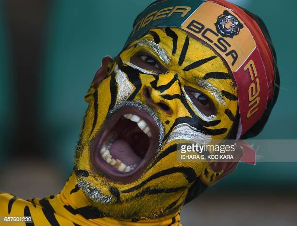 Bangladeshi cricket supporter cheers during the first one day international cricket match between Sri Lanka and Bangladesh at The Rangiri Dambulla...