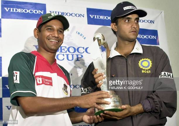 Bangladeshi cricket team captain Habibul Bashar and his Indian counterpart Sourav Ganguly hold the three One Day International match series trophy as...