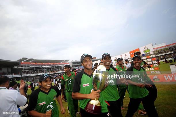 Bangladeshi cricket team captain Shakib Al Hasan celebrates with the trophy after winning the last onedayinternational cricket match between...