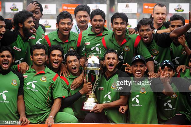 Bangladeshi cricket team cheer with the champion trophy after the last onedayinternational cricket match between Bangladesh and New Zealand at Shere...