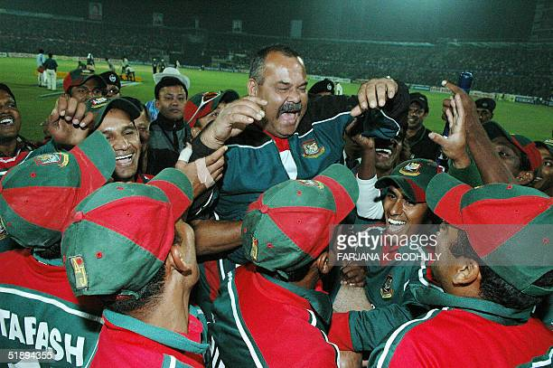 Bangladeshi cricket team coach Dev Whatmore screams in joy as he joins his players as they celebrate their victory over India at the end of the...