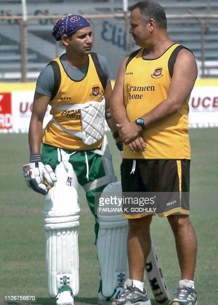 Bangladeshi cricket team coach Dev Whatmore talks with team captain Habibul Bashar during a practice session at the Bir Shrestha Shahid Ruhul Amin...