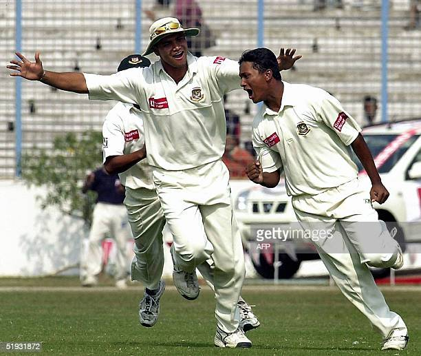 Bangladeshi cricketer Enamul Haque celebrates with his teammates after dismissing Zimbabwean batsman H Masakadza during the fifth and final day of...