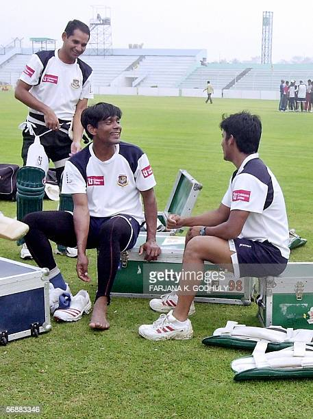 Bangladeshi cricketer Habibul Bashar Mohammad Rafique and Mohammad Ashraful chat during a practice session at the Shahid Chandu Cricket Stadium in...