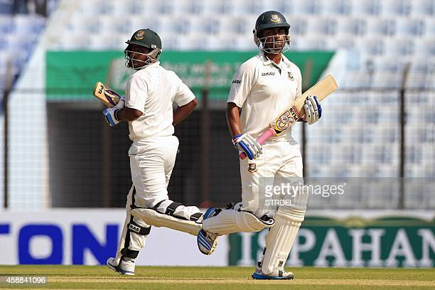 Bangladeshi cricketer Imrul Kayes and Tamim Iqbal run between the wickets during the first day of the third cricket Test match between Bangladesh and...