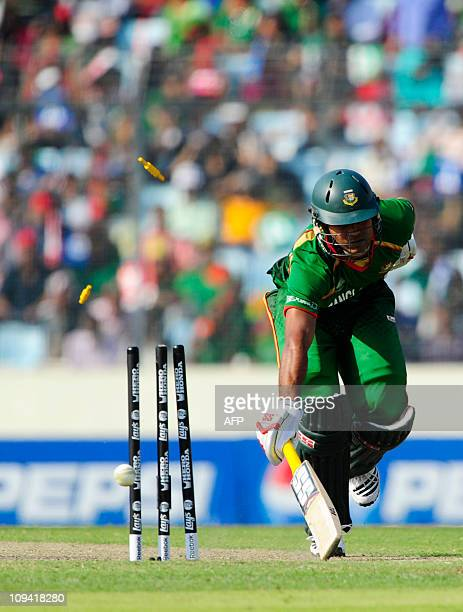 Bangladeshi cricketer Junaid Siddique dives to the crease during the Cricket World Cup tournament match between Bangladesh and Ireland at The Shere...