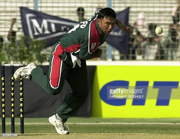 Bangladeshi cricketer Khaled Mahmud delivers a ball during the third One day International between Bangladesh and Zimbabwe at The MA Aziz Stadium in...