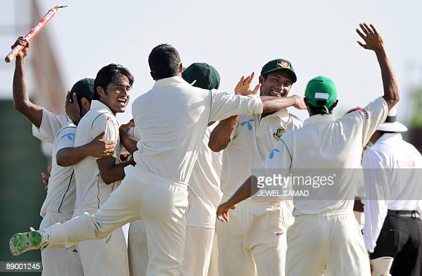 Bangladeshi cricketer Mahmudullah celebrates with teammates following their victory at the end of the final day of the first Test match between West...