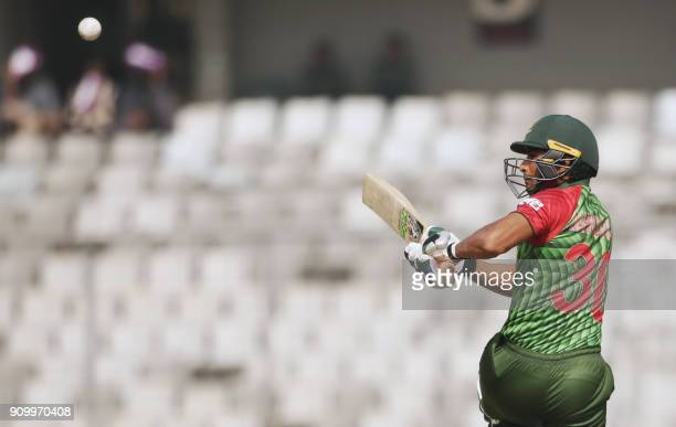 Bangladeshi cricketer Mahmudullah plays a shot flag during the sixth One Day International match in the TriNations series between Bangladesh and Sri...