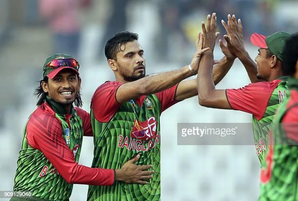 Bangladeshi cricketer Mashrafe Bin Mortaza celebrates after the dismissal of Zimbabwe batsman Craig Ervine during the fifth one day international...