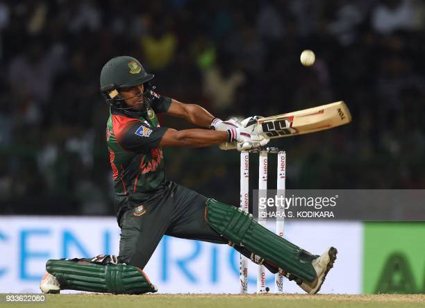 Bangladeshi cricketer Mehidy Hasan Miraz plays a shot during the final Twenty20 international cricket match between Bangladesh and India of the...