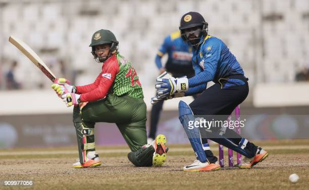 Bangladeshi cricketer Mushfiqur Rahim plays a shot flag during the sixth One Day International match in the TriNations Series between Bangladesh and...