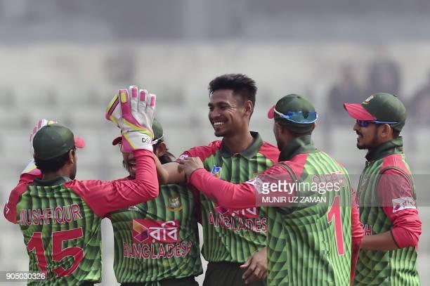 Bangladeshi cricketer Mustafizur Rahman celebrates after the dismissal of Zimbabwe's Brendan Taylor during the first One Day International cricket...