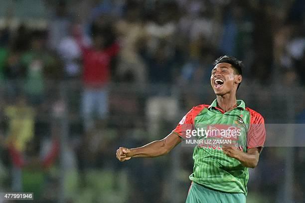 Bangladeshi cricketer Mustafizur Rahman celebrates after the dismissal of the Indian cricketer Ravindra Jadeja during the second ODI cricket match...