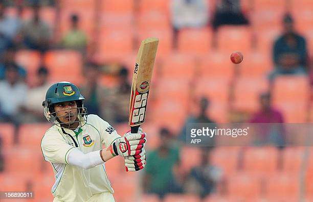 Bangladeshi cricketer Nasir Hossain plays a shot during the fourth day of the second cricket Test match between Bangladesh and The West Indies at The...