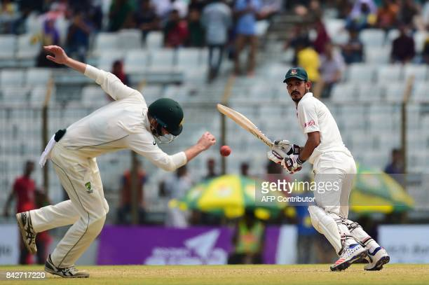 Bangladeshi cricketer Nasir Hossain plays a shot during the second day of the second cricket Test match between Bangladesh and Australia at Zahur...