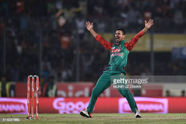 Bangladeshi cricketer Nasir Hossain unsuccessfully appeals for a Leg Before Wicket decision against Indian cricketer Shikhar Dhawan during the Asia...