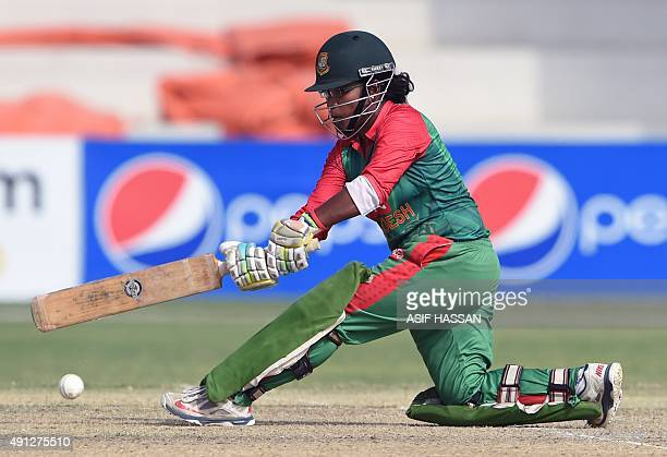 Bangladeshi cricketer Rumana Ahmed plays a shot during the first women's One Day International cricket match between Pakistan and Bangladesh at the...