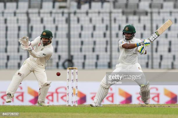 Bangladeshi cricketer Sabbir Rahman plays a shot during the third day of the first Test cricket match between Bangladesh and Australia at the...
