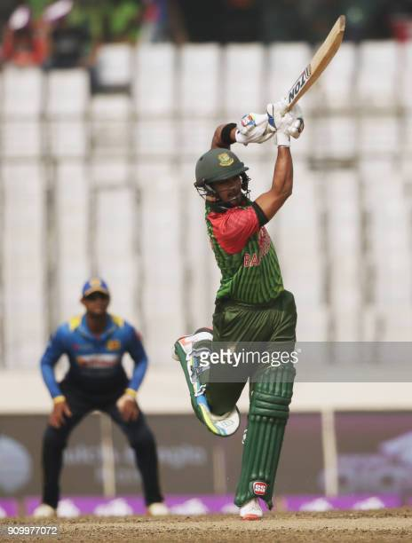 Bangladeshi cricketer Sabbir Rahman plays a shot flag during the sixth One Day International match in the TriNations Series between Bangladesh and...