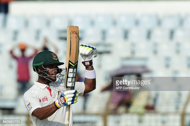 Bangladeshi cricketer Sabbir Rahman reacts after scoring a half century during the first day of the second cricket Test match between Bangladesh and...