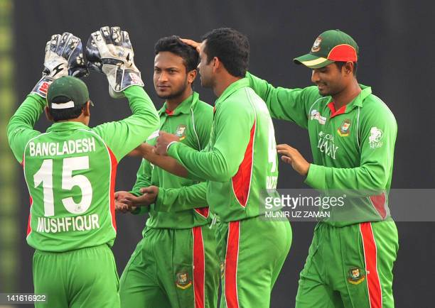 Bangladeshi cricketer Shakib Al Hasan celebrates with his teammates after the dismissal of the Sri Lankan batsman Farveez Maharoof during the one day...