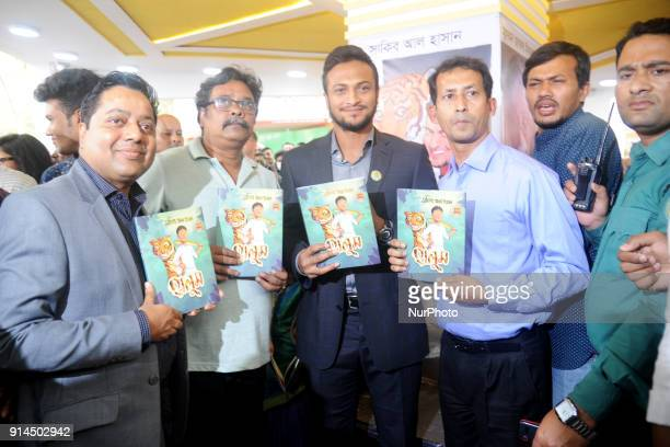 Bangladeshi Cricketer Shakib Al Hasan hold up with others guest his written a book name is quotHalumquot at Parl Publications stall in Ekushey Book...