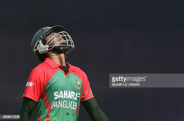 Bangladeshi cricketer Shakib Al Hasan reacts after being dismissed by Indian cricket captain Suresh Raina during the One Day International cricket...