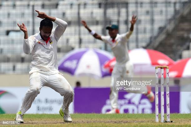 Bangladeshi cricketer Shakib Al Hasan reacts after the dismissal of the Australian cricketer Matthew Wade during the fourth day of the first Test...