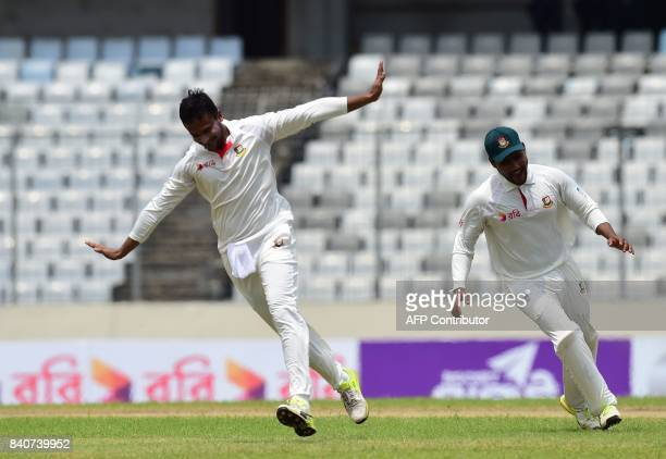 Bangladeshi cricketer Shakib Al Hasan reacts after the dismissal of Australian cricketer Glenn Maxwell during the fourth day of the first Test...