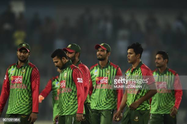 Bangladeshi cricketer Shakib Al Hasan walks off the field after winning the third one day international cricket match of the TriNations Series...
