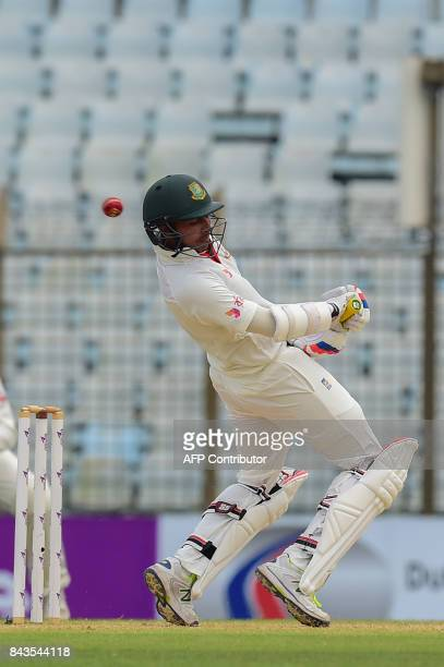 Bangladeshi cricketer Soumya Sarkar tries to avoid a bouncer form Australian player Pat Cummins during the fourth day of the second cricket Test...