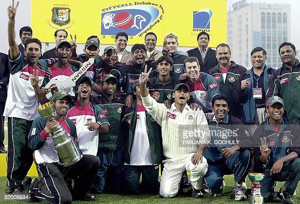 Bangladeshi cricketers and officials pose with the series trophy at the conclusion of the second Test match between Bangladesh and Zimbabwe at the...