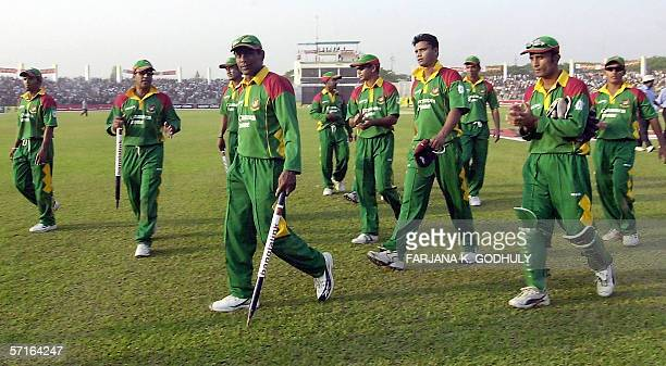 Bangladeshi cricketers are led by Mohammad Rafique as they leave the field after victory in the third One Day International between Bangladesh and...