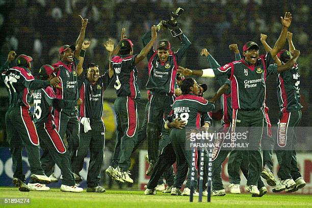 Bangladeshi cricketers celebrate their victory over India at the end of the second One Day International match between Bangladesh and India at the...