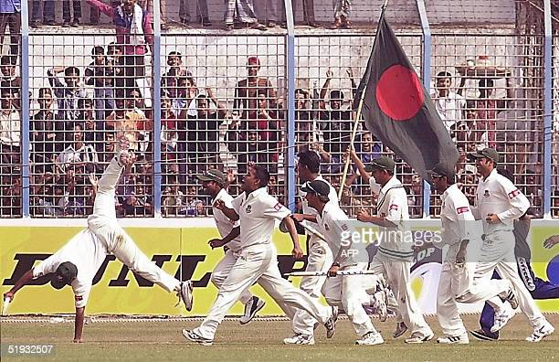 Bangladeshi cricketers celebrate their victory over Zimbabwe at the M. A. Aziz Stadium in Chittagong, 10 January 2005. Bangladesh recorded their...