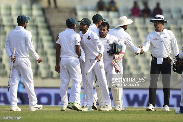 Bangladeshi cricketers celebrate their win at the end of the third day of the second Test cricket match between Bangladesh and West Indies at the...