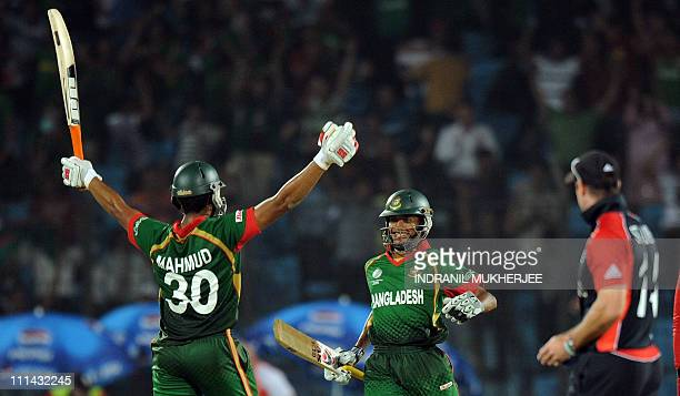 Bangladeshi cricketers Mahmudullah and Shafiul Islam celebrate after scoring the winning runs as England captain Andrew Strauss looks on during the...