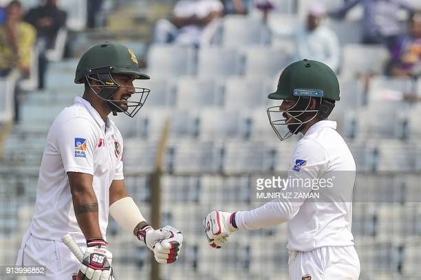 Bangladeshi cricketers Mominul Haque and Liton Das gesture during the fifth and final day of the first cricket Test between Bangladesh and Sri Lanka...