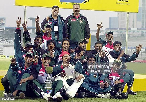 Bangladeshi cricketers pose with the series trophy at the conclusion of the second Test match between Bangladesh and Zimbabwe at the Bangabandhu...