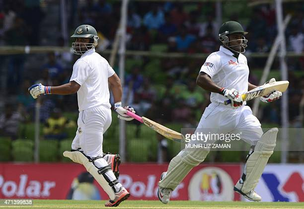 Bangladeshi cricketerS Tamim Iqbal and Imrul Kayes run between the wickets during the first day of the first cricket Test match between Bangladesh...
