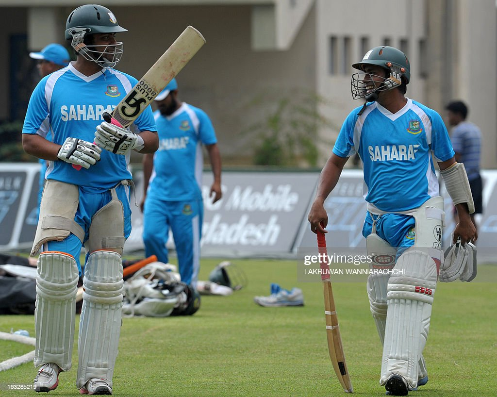 Bangladeshi cricketers Tamim Iqbal (L) and Mohammad Ashraful (R) walk during a practice session at the Galle International Cricket Stadium in Galle on March 7, 2013. Bangladesh will play two Tests, three one-dayers and one Twenty20 during their month-long tour of Sri Lanka, with the first Test starting at Galle on March 8.