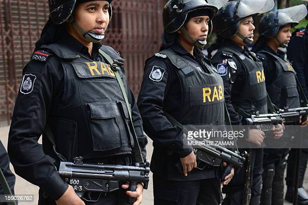Bangladeshi elite force Rapid Action battalion members stand guard in front of the Bangladesh Nationalist Party office during a nationwide strike in...