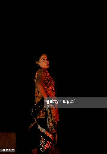 A Bangladeshi eunuch castrated male locally named Hijra displays an outfit during a fashion show in Dhaka on August 18 2009 A Bangladeshi...