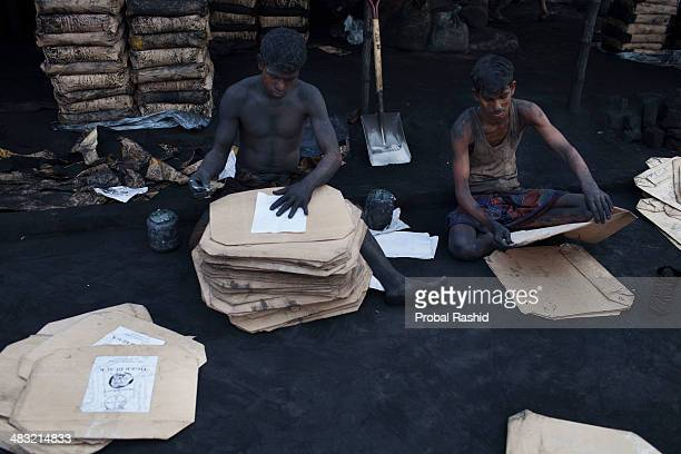 Bangladeshi factory workers work as labourers at a black oxide factory All the workers in this factory come from northern part of the country and...