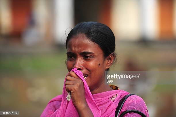 Bangladeshi family member waits for her missing relatives dead body, believed to be trapped in the rubble of an eight-storey building collapse, in...